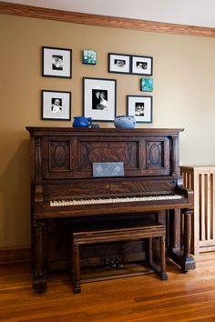 piano display, home photos and artifact arrangement, custom radiator cover, neutral taupe walls with blue accents in artifacts