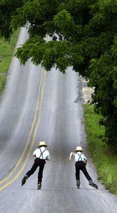 Amish rollerbladers- This reminds me of what I see so often this time of year on our hill!  They also ride scooters past the house, but not bicycles.