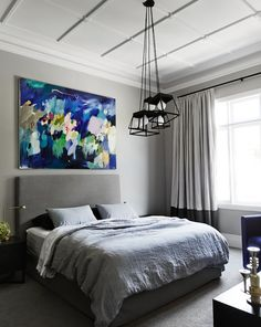 Wall art creating a color spot in bedroom. Interiors created by Mim Design.