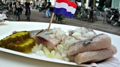 Raw herring served on rolling street carts - order in a sandwhich