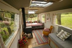 camper / bus living room. love all the windows!