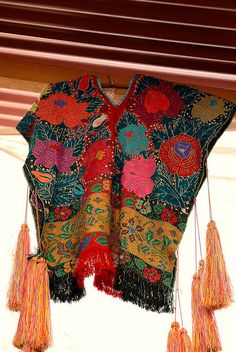 Zinacantan Poncho by Teyacapan, via Flickr - We love the color, patterns, variety and workmanship that go into the beautiful hand made textiles of Mexico - to see more visit www.mainlymexican... #Mexico #Mexican #textile #embroidery #woven
