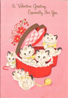 Vintage Valentine card with a heart-shaped box of kittens.