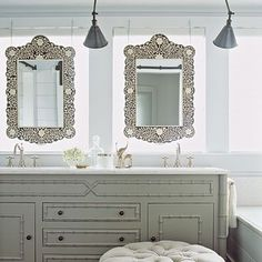 mirrors in front of the windows = goood light for putting on makeup. love the metal swing arm sconces