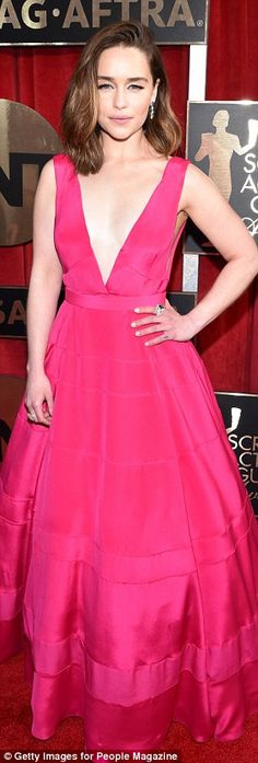 Colour pop: Emilia has never looked better, opting for a dramatic jewel coloured ballgown...