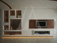 A new look for T.V lounge interior designing with proper utilization of resources by Amer Adnan Associates.