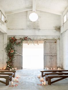 Rustic barn wedding ceremony: http://www.stylemepretty.com/little-black-book-blog/2017/02/24/intimate-wedding-with-views-of-the-pacific-ocean Photography: Ashley Ludaescher - http://ashleyludaescher.com/