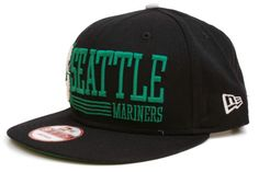 NEW ERA Seattle Mariners 9Fifty Snapback    Black / Green / Silver    This 9FIFTY cap features an embroidered (raised) Seattle Mariners team namesake and logo with stripe accents at front, contrasting color underside visor, and stitched New Era flag at wearer's left side. A snapback closure for an adjustable fit. Interior includes branded taping and a moisture absorbing sweatband.    New Era flag may vary in color with the image featured on site.    100% Wool.