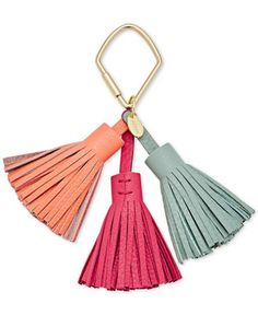 "This trio of leather tassels clips onto your favorite Fossil handbag for a dash of personal style. | Leather | Imported | Triple tassel design with shiny gold-tone hardware | 2"" W x 4-1/2"" H x 2"" D 