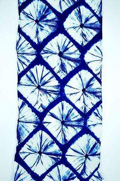 A yukata panel from Arimatsu handwoven of fine cotton and kumo-shibori dyed with indigo. Available from ClothRoads.