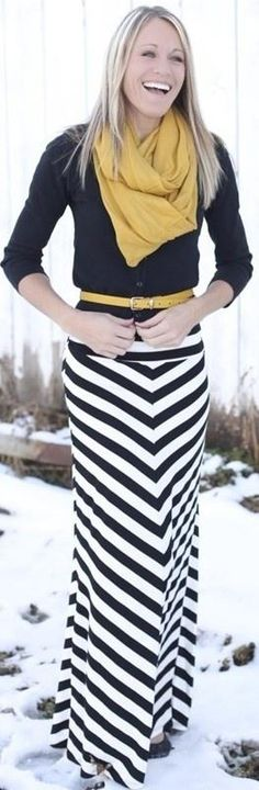 Chevron patterned black and white maxi, black top and mustard scarf~ You'd look cute in this! @elizabethbeller