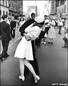 "NYC. Times Square, August 14, 1945 (V-J Day) ""Sailor kissing a nurse celebrating the surrender"" by Alfred Eisenstaedt. / The photographer took 4 shots in 10 seconds. This is the only one in which you can see a girl just behind the sailor's arm. She is Rita, his real girlfriend, watching the scene. This has been a conclusive proof to find out the real sailor among several ""candidates""."