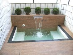 Clean lines, planter, water-feature, privacy, what more could you want! Learn hot to build a project like this for yourself! Visit: www.custombuiltspas.com