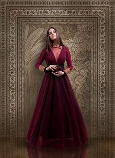 Wine Colour Gown with Sheer Neck and Full Sleeves Cocktail Outfits – Marsala Gown with Net Detailing on Neck Indian Wedding Gowns, Indian Gowns Dresses, Indian Bridal Outfits, Indian Designer Outfits, Gown Wedding, Indian Weddings, Indian Outfits Modern, Designer Dresses, Real Weddings