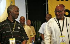 South African President Thabo Mbek, left, and Deputy President Jacob Zuma, pause at the African National  Congress conference in Polokwane, Limpopo province, South Africa, on Sunday, Dec. 16, 2007. Jacob Zuma should become South Africa's next president when Thabo Mbeki's term expires, according to 41% of people polled in a survey.  Photographer: Greg Marinovich/Bloomberg News