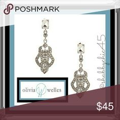 """Joanna Deco Glass Crystal Cutout Drop Earrings Absolutely stunning art deco style earrings made from glass crystals and set silver plated metal alloy.  2.25"""" in length and .75"""" in width.  The prism cut glass crystals will frame your face in eye-catching sparkles as they reflect the light wherever you turn. Olivia Welles is a designer jewelry brand sold in high-end stores & boutiques across the globe.   ??Smoke free home. No trades. Open to reasonable offers unless marked as firm. Happy…"""