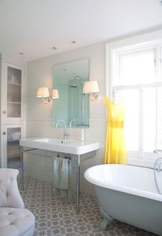 "Love the ""hotel"" style sink, claw foot tub, and fab tile! (And the dress is cute too!)"