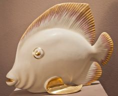 Porcelain fish, ivory and painted gold
