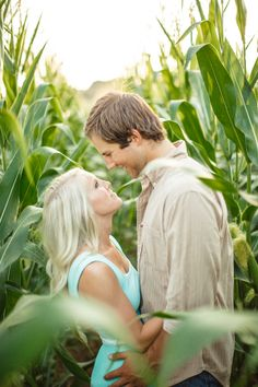 I love the idea of having engagement photos in a cornfield! by JoPhoto. see more on this farm engagement session in Tennessee on the blog! http://www.thebridelink.com/blog/2014/03/31/farm-engagement-photos-in-knoxville/