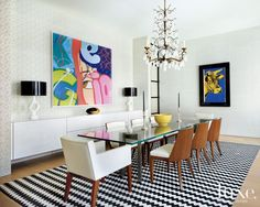 A zigzag rug by Madeline Weinrib adds visual interest to this dining room. Luxe interiors+design