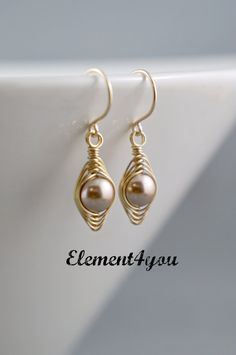 REMEMBER TO LET ME KNOW YOUR PEAS COLOR AT CHECK OUT UNDER MESSAGE TO SELLER. A cute pair of earrings made with 8 mm Swarovski pearl wrapped with non tarnish wire to form a pea in a pod. The earrings are hung on 14k gold filled earwires. Available with 1, 2, 3, 4 or 5 peas. Please state