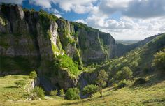 Most canyons were formed by a process of long-time erosion from a plateau or table-land level. The cliffs form because harder rock strata that are resistant to erosion and weathering remain exposed on the valley walls. Cheddar Gorge, Somerset, England (© James Osmond Photography/Alamy)