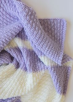 This easy knit baby blanket pattern is super fun and also easy to knit. All you need to know is how to cast on, knit, purl and bind off!