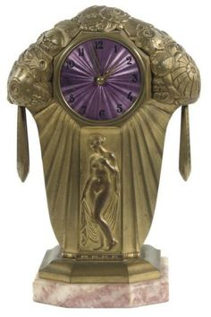 A FRENCH GILT-BRONZE ART DECO STRIKING MANTEL CLOCK CIRCA 1925, THE CASE BY PIERRE FARGETTE, THE MOVEMENT BY VICENTI The case with stylized flowers to the top and centred by a relief of a standing female nude, stamped P. Fargette to the base, purple enamel dial, eigth day twin barrel movement; winding key, pendulum
