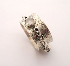 Hey, I found this really awesome Etsy listing at http://www.etsy.com/listing/60486789/sterling-silver-spinner-ring-with