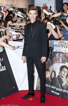 All grown up: Love Actually star Thomas Brodie-Sangster hit the premiere of his new movie Maze Runner: The Scorch Trials in Seoul, South Korea on Wednesday