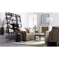 Davis Sofa, Pelliccia Pillow, Caney Pillows, Aerie Small Accent Table, Parsons Square Coffee Table, Sloane Leaning Bookcase/Wine Bar, Orissa Rug I Crate and Barrel