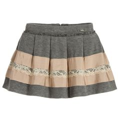 Girls grey skirt, made with a soft viscose jersey by Mayoral. It has dusky pink grosgrain ribbon and ivory lace trims, with a delicate ruffle on the waist. It has pleats around the waist which add a lovely flare. Fastening with a zip the waist is adjustable allowing it to be made smaller and it is lined with cotton.