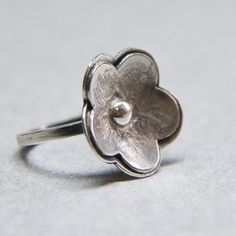 Textured sterling silver flower