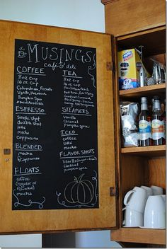 Chalkboard for shopping list on inside of kitchen cabinet door