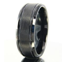 All black mens wedding band. Designed with brushed center with two channel grooves and polished beveled edges. See more here: https://northernroyal.com/collections/black-tungsten-rings/products/black-tungsten-wedding-band-groove-tungsten-wedding-band-black-grooved-tungsten-wedding-band-grooved-wedding-band-wedding-ring-black