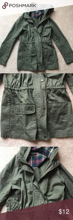 Green Type Hooded Jacket with Plaid Accents Green 100% cotton jacket with drawstrings on inside to cinch waist. (See photos) Zip and button closure. Two front button pockets. One zip pocket by chest. Plaid lining on hood. Plaid elbow patch. Purchased at boutique. Jackets & Coats Utility Jackets