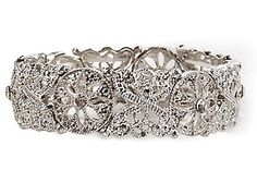 Add elegance to that special occasion with this stretch bracelet that features shiny marcasite set in silver tone metal and a flower design.
