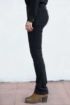 AVAILABLE FOR PRE-ORDER Pants will ship in JANUARY 2015  88% Polyester 12% PU Machine wash Made In USA  We never take these pants off. Well, almost. Our fashion designer tailored  them to fit a woman's body at the natural waist, and accentuate the legs.  The slight bootcut is made to snuggly fit over your boots, or you can  easily tuck the pant into taller boots. The outside of the fabric is water  repellent (we've spilled tea on the samples several times, and it brushes  right off!), and…