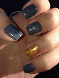 Gray nails, with gold accent.