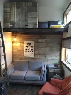 I like the size and shape of the window. Living Room - Tanlers Tiny House