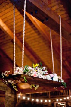 Amy Osaba created this romantic floral chandelier inspired by a swing to decorate the high ceilings in this reception space. Hanging Centerpiece, Floral Centerpieces, Wedding Centerpieces, Flower Arrangements, Wedding Decorations, Chandelier Wedding Decor, Flower Chandelier, Whimsical Wedding, Rustic Wedding
