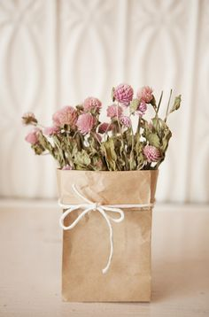 I love this idea of putting flowers in paper bag!