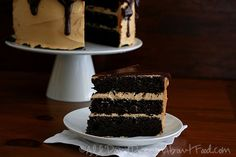 Dark Chocolate Peanut Butter Layer Cake – Low Carb and Gluten-Free Recipe Desserts with almond flour, cocoa, coconut flour, whey protein powder, instant coffee, baking soda, cream of tartar, salt, butter, Swerve Sweetener, large eggs, vanilla extract, stevia extract, almond milk, apple cider vinegar, cream cheese, butter, creamy peanut butter, Swerve Sweetener, heavy cream, vanilla extract, butter, unsweetened chocolate, Swerve Sweetener, vanilla extract
