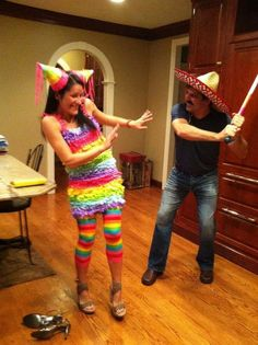 Male ready to beat the pinata... aka the woman... this doesn't promote violence against women at all... -.-