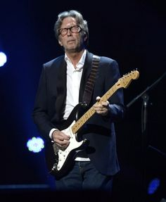 "Eric Clapton perfoms at the ""12-12-12"" concert benefiting victims of Hurricane Sandy."