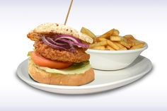 Spicy Bean Burger - Spicy Bean Burger with a crisp Lettuce Leaf, thick sliced Tomato and Onion. Served with a Garlic  Mayo Dip and Chips.