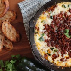 Queso fundido is more fun with chorizo! This dip is super simple, but bursting with flavor and great for party snacking!