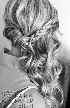 Curled half updo swept to the side