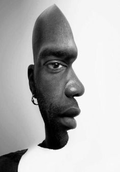 Man with two faces - unknown photographer - the idea of a portrait en face and in profile is of Erwin Blumenfeld - this picture went viral on social media start 2014 - first time I can found  it is 2009/12/26 http://bolstablog.wordpress.com/2009/12/26/optical/