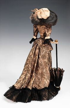 """1892 Doll"" Germaine Lecomte  Designer: Suzanne Talbot Designer: Vedrenne (French) Designer: Jean Clemént (French, 1900–1949) Date: 1949 Culture: French Medium: metal, plaster, hair, silk, wood, horse hair, feather Dimensions: 30 1/2 x 16 in. (77.5 x 40.6 cm) Credit Line: Brooklyn Museum Costume Collection at The Metropolitan Museum of Art, Gift of the Brooklyn Museum, 2009; Gift of Syndicat de la Couture de Paris, 1949"